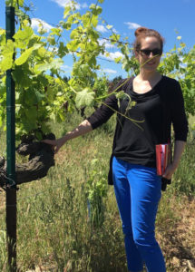 Vanessa, Sales Manager at Bourget in the vineyard of Chateau Mourgues du Gres
